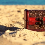 a treasure chest on a sandy beach