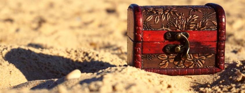 a treasure chest on a sandy beach